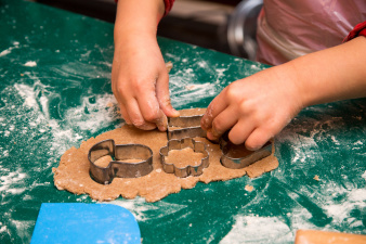 Children stamp out the biscuit shapes